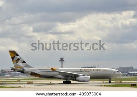 FRANKFURT,GERMANY-APRIL 07:airplane of Etihad Airways in the Frankfurt airport on April 07,2016 in Frankfurt,Germany.Etihad Airways- the second-largest airline, of the United Arab Emirates. - stock photo