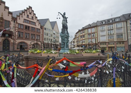 Frankfurt, Germany - April 28, 2014: Colored ribbons tied by children around the statue in the old town square in central Frankfurt, Germany on April 28, 2014 - stock photo