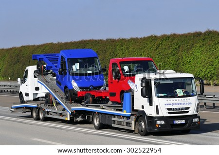 FRANKFURT,GERMANY-APRIL 10:IVECO truck with cars on the highway on April 10,2015 in Frankfurt,Germany. - stock photo