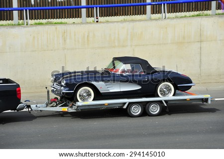 FRANKFURT,GERMANY-APRIL 16:old car on trailer on the highway on April 16,2015 in Frankfurt,Germany. - stock photo