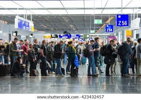 FRANKFURT, GERMANY - APRIL 25, 2016: Passengers waiting in a row for boarding on an airport to a flight to America