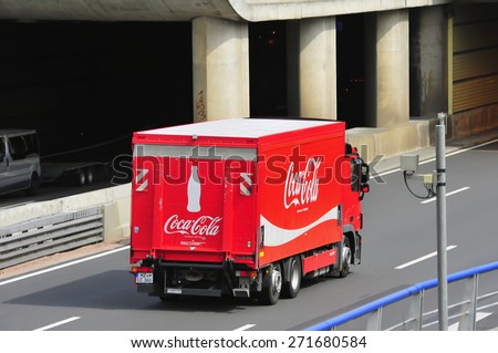 FRANKFURT,GERMANY-APRIL 16:red Coca- Cola truck  on April 16,2015 in Frankfurt,Germany.Coca-Cola is a carbonated soft drink sold in stores, restaurants, and vending machines throughout the world - stock photo