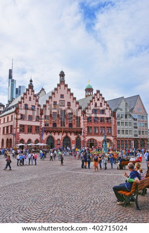 FRANKFURT, GERMANY - APRIL 29, 2012: Romer City Hall in Frankfurt in Germany. The Romerberg consists of old houses. Tourists nearby