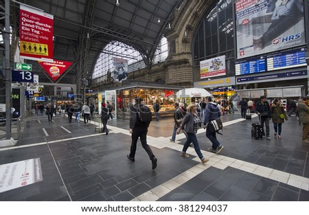 Frankfurt, Germany - April 30, 2014: Train travelers walk around among the kiosks in the central hall of Frankfurt railway station in Frankfurt, Germay on April 30, 2014