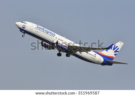 FRANKFURT,GERMANY-AUG 10:Airplane of SunExpress Airlines over Frankfurt airport on August 10,2015 in Frankfurt,Germany.SunExpress is a Turkish airline based in Antalya, Turkey.