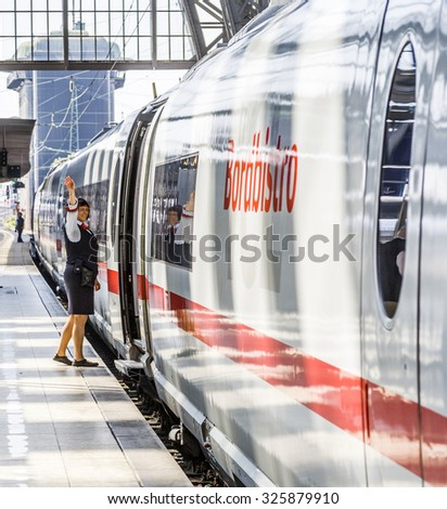 FRANKFURT, GERMANY- AUG 30, 2008: conductor gives the all right sign for leaving the train station at the Frankfurt  train station in Frankfurt, Germany. The station opened in 1888 as dead end station - stock photo