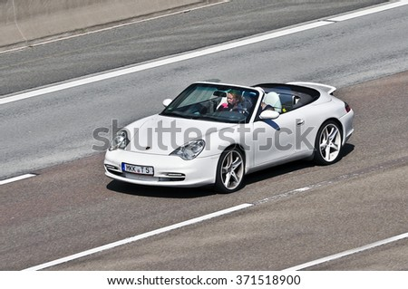 FRANKFURT,GERMANY-AUG 22:porsche on the highway on August 22,2015 in Frankfurt,Germany. Porsche AG, is a German automobile manufacturer specializing in high-performance sports cars, SUVs and sedans. - stock photo