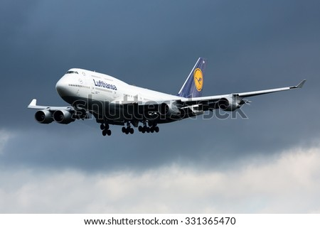 FRANKFURT,GERMANY-AUGUST 23:Boeing 747 (Jumbo Jet) LUFTHANSA approaching airport on August 23,2014 in Frankfurt,Germany. - stock photo
