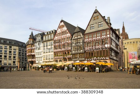 Frankfurt, Germany - August 29, 2013: Historical buildings and people sitting at cafe's on the town square in Frankfurt, Germany on August 29, 2013. - stock photo