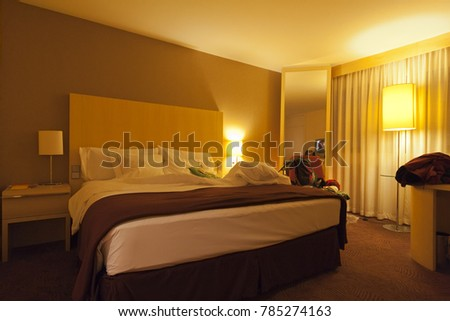 FRANKFURT, GERMANY - AUGUST, 28, 2008: Illuminated hotel room in Frankfurt, Germany
