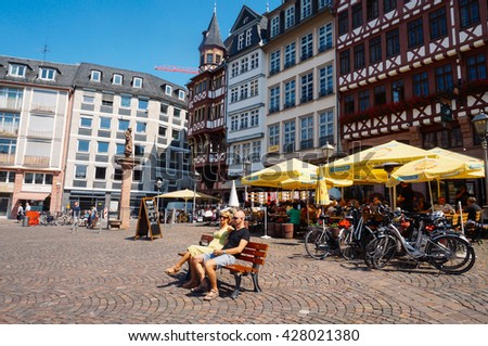FRANKFURT, GERMANY- AUGUST 22, 2015 : People relaxing in the historic center of Frankfurt , Germany. - stock photo