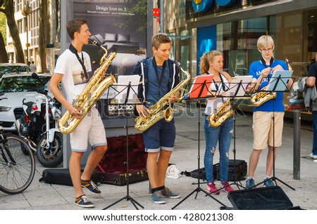 FRANKFURT, GERMANY- AUGUST 22 , 2015: Performance of street musicians in the center of Frankfurt, Germany. - stock photo