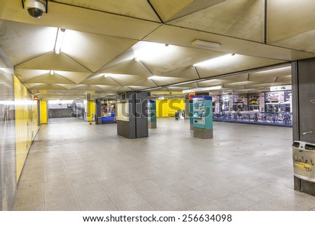 FRANKFURT, GERMANY - FEB 28, 2015:   metro station for S and U-Bahn Eschenheimer Turm in Frankfurt, Germany. The Metro station was inaugurated 1978 after 8 years under construction. - stock photo