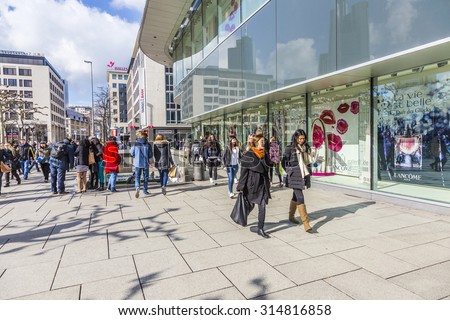 FRANKFURT, GERMANY - FEB 28, 2015: people walk along the Zeil in Midday in Frankfurt, Germany. Since the 19th century it is of the most famous and busiest shopping streets in Germany. - stock photo