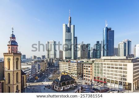 FRANKFURT, GERMANY - FEB 28, 2015: The Katharinen kirche at Hauptwache Pplaza and modern skyscarpes in Frankfurt am Main, Germany. - stock photo