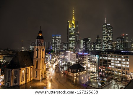 FRANKFURT, GERMANY - FEB 5: view to skyline with Hauptwache and skyscraper by night on February 5, 2013 in Frankfurt,Germany. It is the fifth-largest city in Germany with a 2012 population of 704,449.