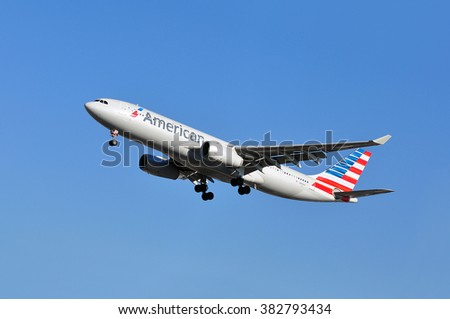 FRANKFURT,GERMANY-FEBR 25:airplane of American Airlines above the Frankfurt airport on February 25,2016 in Frankfurt,Germany.American Airlines headquartered in Fort Worth, Texas.