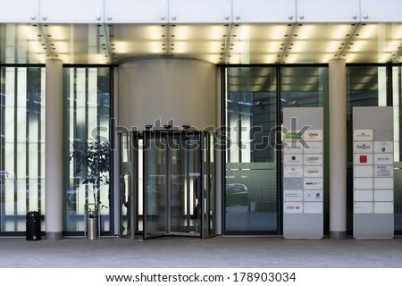 February 19 the entrance of an office building with a revolving door
