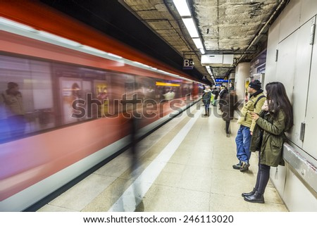 FRANKFURT, GERMANY - JAN 21, 2015: people wait at the metro station for the arriving train in Frankfurt, Germany. The Metro station was inaugurated 1978 after 8 years under construction. - stock photo