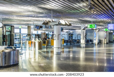 FRANKFURT, GERMANY - JULY 24, 2014: Airport at early morning with open Check in Frankfurt, Germany. In 2012, Frankfurt handled 57.5 million passengers.
