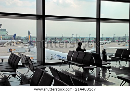 FRANKFURT, GERMANY-JULY 26, 2013: business man at the airport. With 38 million passengers per year it is one of the most important airport in Europe.