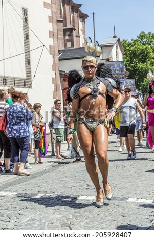 FRANKFURT, GERMANY - JULY 19, 2014: Christopher Street Day in Frankfurt, Germany. Crowd of people, gays, lesbian and bisexuals, participate in the parade celebrating the Christopher street day.