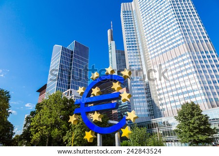 FRANKFURT, GERMANY - JULY 9: Euro sign. European Central Bank headquarters in Frankfurt in Germany  in summer day on July 9, 2014 in Frankfurt, Germany - stock photo