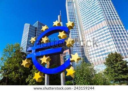 FRANKFURT, GERMANY - JULY 9: Euro sign. European Central Bank headquarters in Frankfurt in Germany  in summer day on July 9, 2014 in Frankfurt, Germany - stock photo