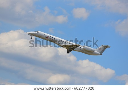 FRANKFURT,GERMANY-JULY 21: Fly Kiss Embraer ERJ-145LR lands at Frankfurt airport on July 21,2017 in Frankfurt,Germany.Fly Kiss is a French start-up airline launched in 2016.
