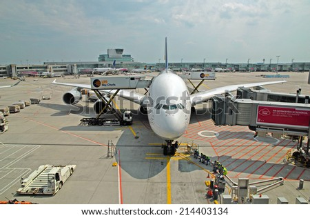 FRANKFURT, GERMANY-JULY 26, 2013: passengers airplane decking. With 38 million passengers per year it is one of the most important airport in Europe.