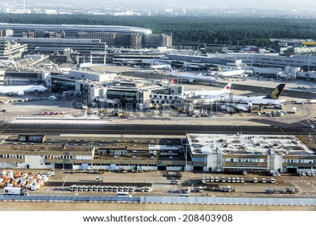 FRANKFURT, GERMANY - JULY 24, 2014: Terminal 2 in sunrise in Frankfurt, Germany. It is one of the busiest airport in Europe with 59 million passengers in 2011.