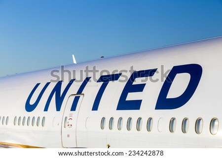 FRANKFURT, GERMANY - JULY 17, 2014: United Airlines aircraft logo at an aircraft in Frankfurt. United Airlines is headquartered in Chicago, Illinois. - stock photo