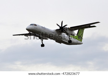 FRANKFURT,GERMANY-JUNE 02: AirBaltic Bombardier Dash 8 above the airport on June 02,2016 in Frankfurt,Germany.AirBaltic, is the Latvian flag carrier airline and a low-cost carrier in Riga,Latvia.