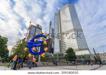 FRANKFURT, GERMANY - JUNE 14: Euro sign in front of the European Central Bank (ECB) on JUNE 14, 2013 in Frankfurt Germany. - stock photo
