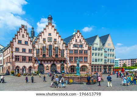 FRANKFURT, GERMANY - JUNE 3, 2014: People on Roemerberg square in Frankfurt, Germany. Frankfurt is the fifth-largest city in Germany, with a population of 687,775. - stock photo