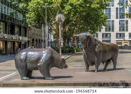 FRANKFURT, GERMANY - JUNE 3, 2014: The Bull and Bear Statues at the Frankfurt Stock Exchange in Frankfurt, Germany. Frankfurt Exchange is the 12th largest exchange by market capitalization. - stock photo
