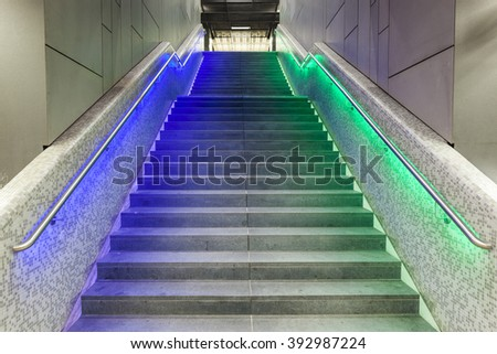 FRANKFURT, GERMANY - MAR 18, 2016: Illuminated steps in the train station at night during Luminale  in Frankfurt, Germany. The Light festival takes place in Frankfurt every 2 years and lasts one week.