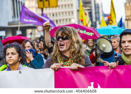 FRANKFURT, GERMANY - MAR 18, 2015: people demonstrate against EZB and Capitalism in Frankfurt, Germany. 30 tsd people demonstrate. They are holding banners. - stock photo