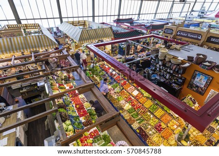 FRANKFURT, GERMANY - MAR 29, 2014: people enjoy shopping in the Kleinmarkthalle in Frankfurt, Germany. The hall from 1954 is the most famous fresh food market in Frankfurt on 1500 SQ (m2).