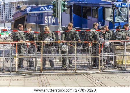 FRANKFURT, GERMANY - MAR 18, 2015: police pays attention at demonstration against EZB and Capitalism in Frankfurt, Germany. 30 tsd. people join the demo. - stock photo