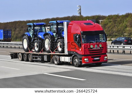 FRANKFURT,GERMANY-MARCH 28:IVECO truck with tractors on the highway on March 28,2015 in Frankfurt,Germany.IVECO is an Italian industrial vehicle manufacturing company based in Turin, Italy. - stock photo