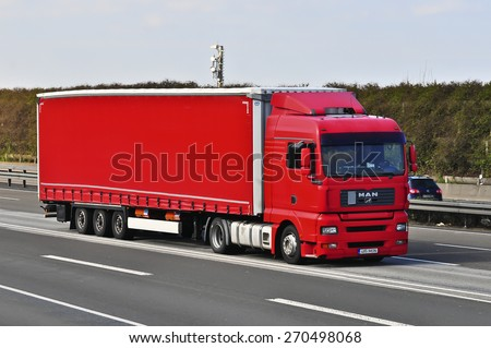 FRANKFURT,GERMANY-MARCH 28:NAN truck on the highway on March 28,2015 in Frankfurt,Germany.MAN SE, formerly MAN AG, is a German mechanical engineering company and parent company of the MAN Group. - stock photo