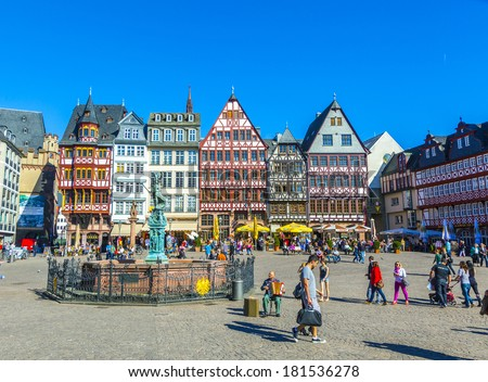 FRANKFURT, GERMANY - MARCH 25: People on Roemerberg square on March 25, 2012 in Frankfurt, Germany. Frankfurt is the fifth-largest city in Germany, with a population of 687,775. - stock photo