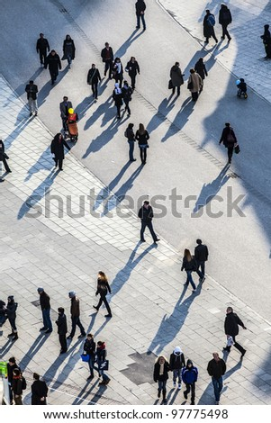 FRANKFURT, GERMANY-MARCH 03: people walk along the Zeil in Midday on March 03,2011 in Frankfurt, Germany. Since the 19th century it is of the most famous and busiest shopping streets in Germany. - stock photo