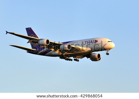 FRANKFURT,GERMANY-MAY 05:Airbus A380 of Thai Airways above Frankfurt airport on May 05,2016 in Frankfurt,Germany.Thai Airways , trading as THAI is the flag carrier airline of Thailand. - stock photo