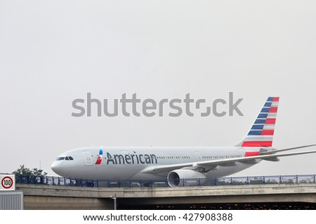 FRANKFURT,GERMANY-MAY 26:airplane of American Airlines in the fog on May 26,2016 in Frankfurt,Germany.American Airlines headquartered in Fort Worth, Texas.