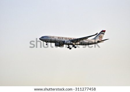 FRANKFURT,GERMANY-MAY 13:airplane of Etihad Airways above the Frankfurt airport on May 13,2015 in Frankfurt,Germany.Etihad Airways is the flag carrier and the second-largest airline of the Emirates. - stock photo