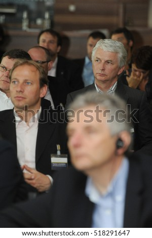 Frankfurt, Germany- May 26, 2009 - Business men listening on trade show and conference in Frankfurt