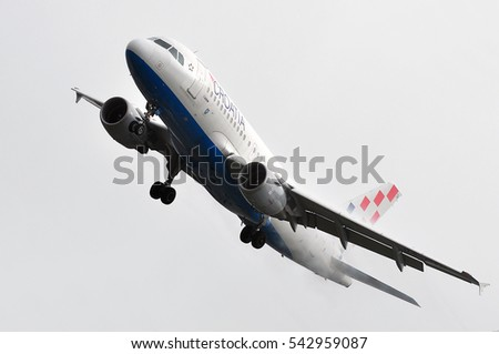 FRANKFURT,GERMANY-MAY 26: Croatia Airlines Airbus A319 landing in the fog on May 26,2016 in Frankfurt,Germany.Croatia Airlines Ltd. is the state-owned flag carrier of Croatia.