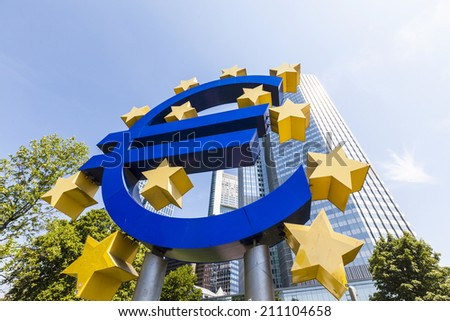 FRANKFURT, GERMANY - MAY 16, 2014: Euro Sign. European Central Bank (ECB) is the central bank for the euro and administers the monetary policy of the Eurozone in Frankfurt, Germany. - stock photo